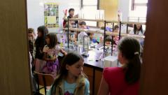 Group of children learning in the laboratory - stock footage