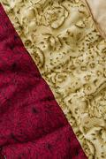 close up from colorful patchwork sheet as texture and background - stock photo