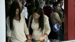 Two young women in the exhibition gallery Stock Footage