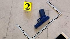 Gun on the crime scene reconstruction Stock Footage