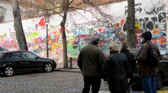 Lennon Wall with people and cars Stock Footage