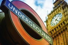 london, uk - september 27, 2013: symbols of london - underground sign and big - stock photo