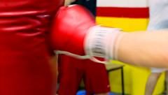 Kickbox fighter punching a heavy bag at a gym Stock Footage