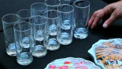 Waiters puts the glass and cakes on the table at the party Stock Footage