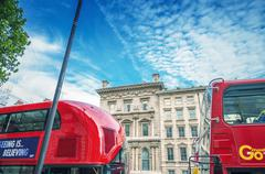 london - september 28, 2013: modern red double decker buses in london. an ico - stock photo