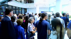 Stock Video Footage of Crowd of people enter in the exhibition gallery