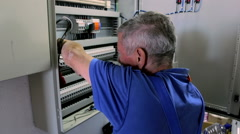 Worker repairs electrical installation in the building Stock Footage