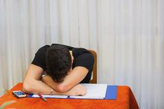 tired or despondent young man - stock photo