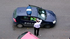 Police checking documents of the driver on the street Stock Footage