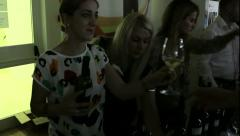 Young women serve wine at private party Stock Footage