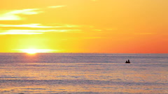 Fishermens drive the boat and go to the fishing at sunset Stock Footage