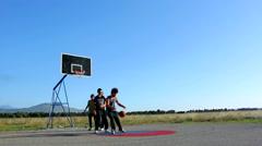 Boy playing street basketball at playground - stock footage