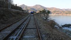 Rail bike tracks by ocean lake in Korea Stock Footage