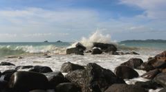 Wave splash at the rocks in the sea Stock Footage