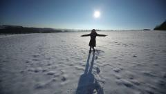 Woman having fun in the snow Stock Footage