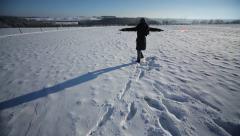 Woman having fun in the snow Stock Footage