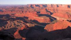 Time-lapse sunrise shadow in desert over Canyonlands NP from DeadHorse point Stock Footage