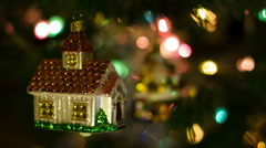 House toy rotates on the New Year Tree Stock Footage