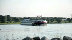 A Large Long Barge Passing by Stock Footage