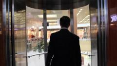 Businessman go into the elevator trade center and door of lift close Stock Footage