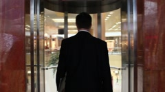 The boss comes in a lift in the office of the big insurance company - stock footage