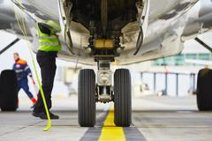 Airplane parked at the airport and preparation for next flight. Stock Photos