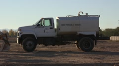 Non-potable water truck at construction site 02 Stock Footage