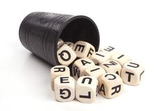 Stock Photo of dice cup with character dices over white
