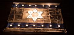 Israeli Flag Candle Light - stock photo