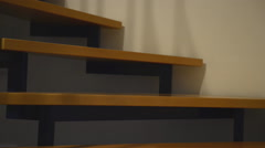Couple undressing on stairs Stock Footage