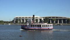Ferry boat passes convention center, savannah, ga, usa Stock Footage