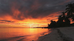 Golden sunset at idyllic white beach Stock Footage