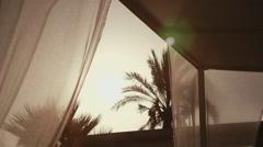 Wedding decorated kiosk outdoors summer resort veil palm trees sunset Stock Footage