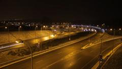 A timelapse of a road at night. Winter, snowing. Clip 01. - stock footage