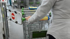 Shopping trolleys gathering Stock Footage