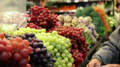 Shopping for fruit at a public market Stock Footage