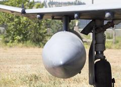 bomb on the wings of a Fighter jet - stock photo