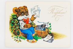 Reproduction of antique postcard shows bear in sneakers, jeans, Stock Photos