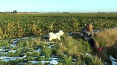 Teenage girl and dog in snowy farmland Stock Footage