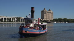 Ferry boat or river taxi arrives at waterfront, savannah, ga, usa Stock Footage