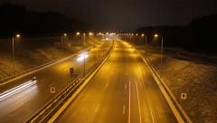 A timelapse of a road at night. Winter, snowing. Clip 03. - stock footage