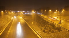 A timelapse of a road at night. Winter, snowing. Clip 02. - stock footage