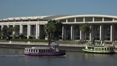 Ferry boat passes convention center, savannah, ga, usa Stock Footage