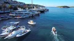 Hvar, Croatia harbour following boat going fishing from aerial drone overhead 26 - stock footage
