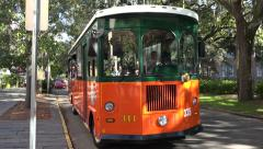 Old town trolley tour departs from stop, savannah, ga, usa Stock Footage