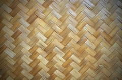 wooden wall made from bamboo and rattan with black vignette. - stock photo