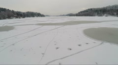 Flying over icy fresh water in the winter Stock Footage