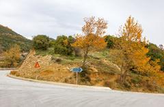 Curved asphalt road at meteora mountains, greece Stock Photos
