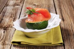 fresh avocado and slice of smoked salmon - stock photo
