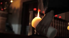 Holding faith candle Stock Footage
